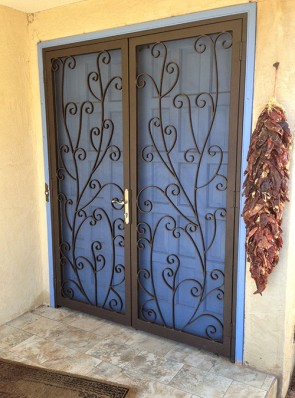 Pair of security pre hung screen doors with slim line lock and scroll design