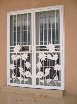 Pair of security screen doors in sunflower design