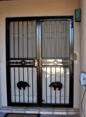 Pair of security storm doors with High Desert in center and Zuni bears on bottom