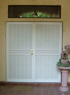 Pair of security screen doors with perforated metal in fancy caprice design