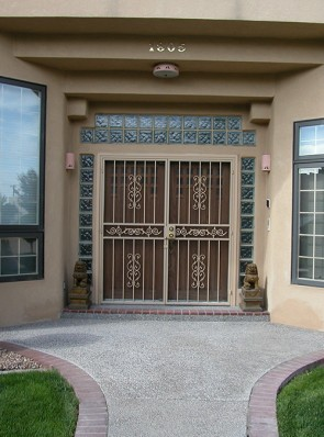Pair of security pre hung doors in Sunbird design with center scroll