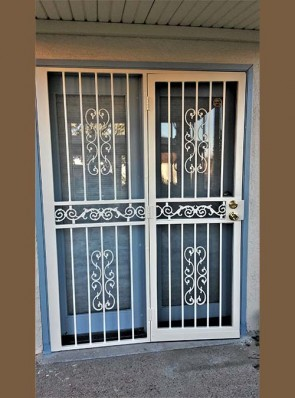 Security pre-hung screen door and sidelight in Heritage design and center scroll