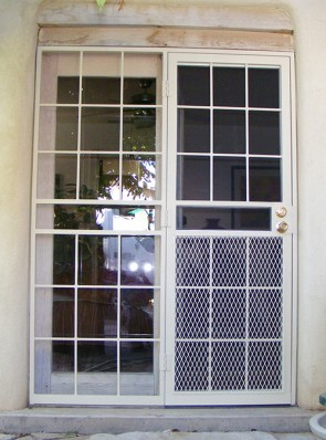 Security pre-hung screen door with sidelight in Divided light design and expanded metal on bottom