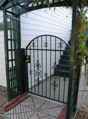 """Arched gate with 3/4"""" expanded metal and Caprice and C scrolls design"""