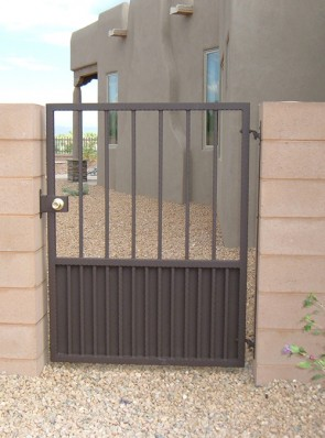 Gate with doggie pickets and solid metal on bottom
