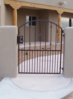 Arched gate with Knuckles and Baskets design and doggie pickets