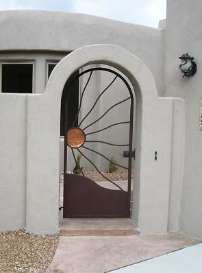 Arched gate with Windblown Copper Sun design