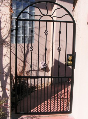 Arched gate with Wavy Sun , Knuckles, Baskets, and doggie pickets