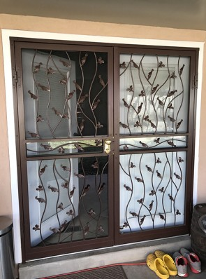 Pair of security storm doors in wavy leaf design