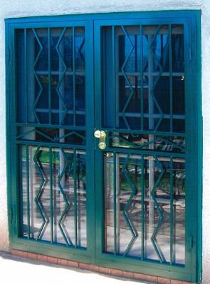 Pair of security storm doors in alternating zig-zag design