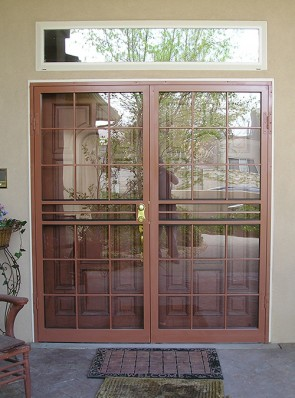 Pair of security storm doors in divided light design