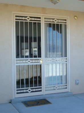 Pair of  8' high security storm doors in high desert design