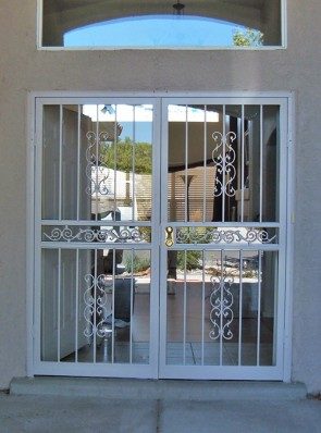 Pair of security storm doors in sun bird design