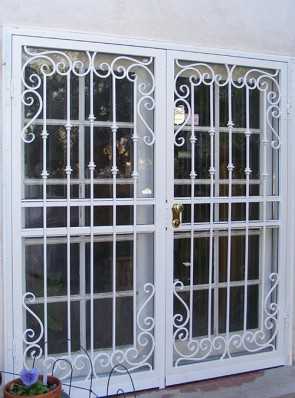 Pr. of Security storm doors with Forged Scrolls and Knuckles design
