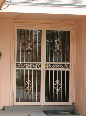 Pair of security storm doors in Sundance design with center scroll