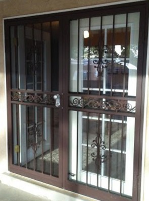 Pair of security storm doors in sundance design