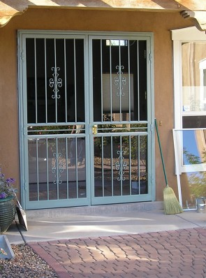 Pair of 8' high security storm doors in seville design with straight bars