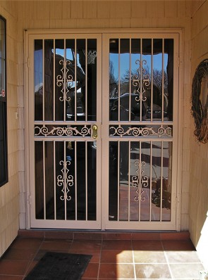 Pair of  security storm doors in Seville design with center frieze in the middle