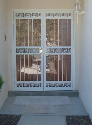 Pair of security storm doors in greek key design