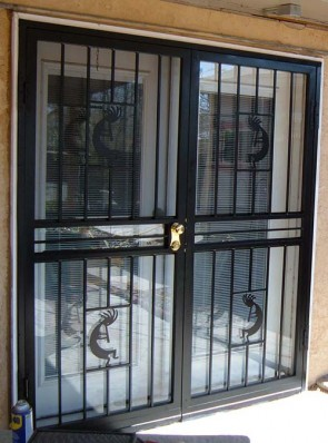 Pair of security storm doors in kokopelli design