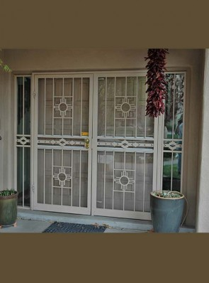 Pair of security storm doors in zia design with high desert in the center and sidelights