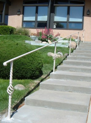 Handrailing with moulded cap and custom Twist, Baskets posts and Volute
