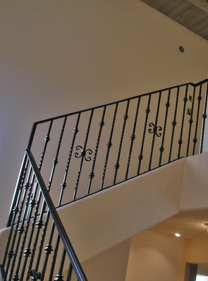 Custom stairway railing with C scrolls, Knuckles and twist
