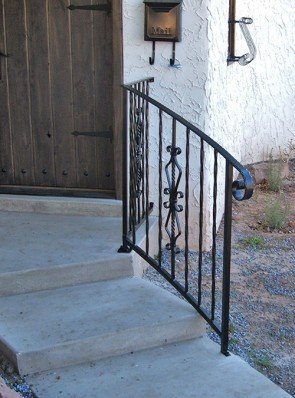 Sloped and Curved step railing with Forged scrolls and Twist with Volute
