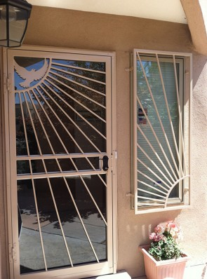 Security Storm door in Reversed Sunray design with Dove and window grill in Sunray design
