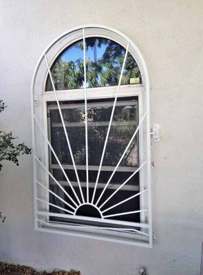 Arched window grill in Sunray with Bent Bar design