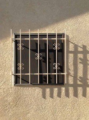 Window grill with C scroll design
