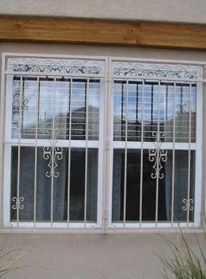 Window grill in Center Frieze, Seville and C scroll design