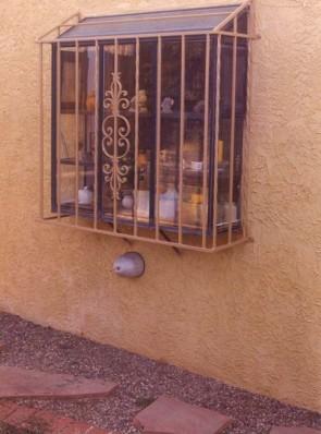 Atrium window grill with Caprice design with twist