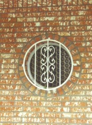 Round window grill in Heritage design
