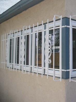 Corner window grill with Sunbird design