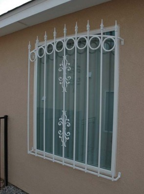 Window grill with arched top, spears, Circles and Sundance design