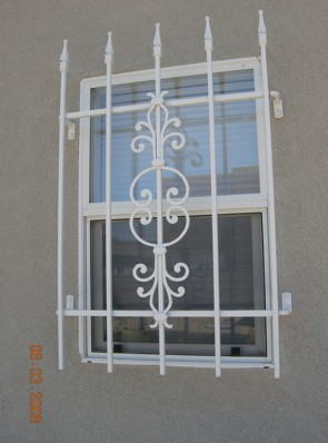 Window grill with Spears and Caprice design