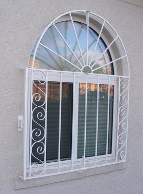 Arched window grill with Sunray and S scrolls design