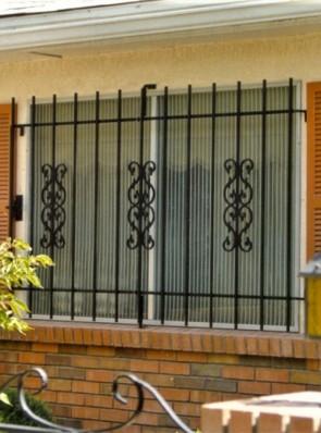 Window grill with emergency release in Sunbird design