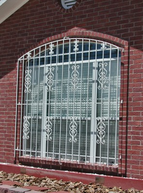 Eyebrow top window grill with Sunbird and C scrolls design