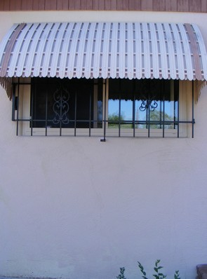 Window grill under awning in Sunbird design