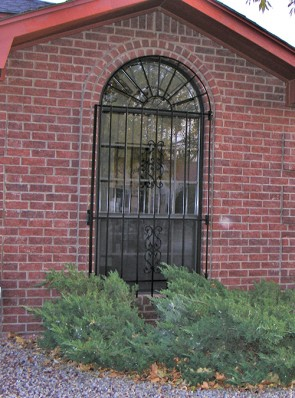 Arched window grill with Sunbird design