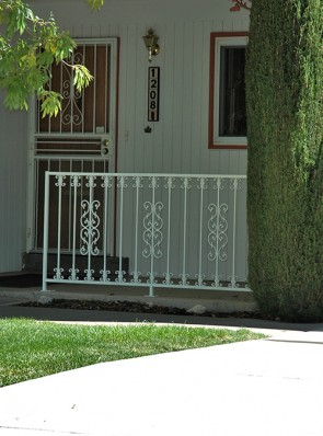 Porch railing with Sunbird and C scroll design