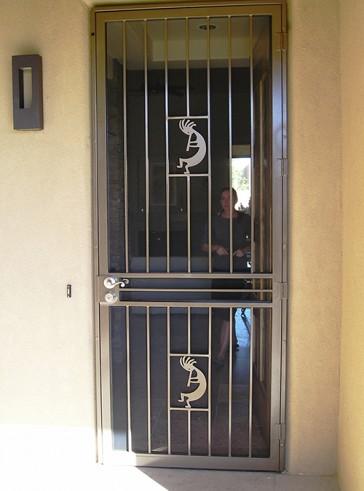 8' high Security pre-hung screen door with Kokopelli design