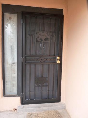 Security pre-hung screen door with Zuni bears and High Desert design in center