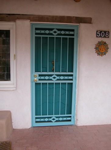 Security pre-hung screen door in High Desert design