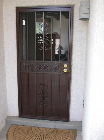 Security pre-hung door with Heritage design, center scroll and perforated on bottom and center, screen on top