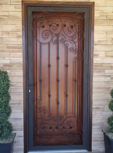 Security door with Forged scrolls and Knuckles design
