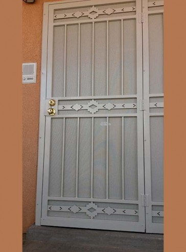 Security pre-hung door with sidelight in High Desert design and perforated metal