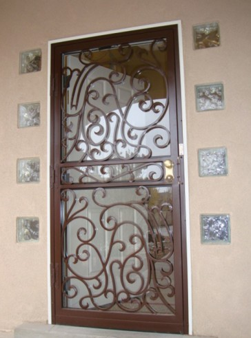 Security storm door in Forged scroll design